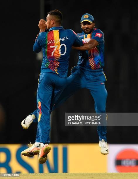 Sri Lankan cricketer Amila Aponsu and Danushka Gunathilaka celebrates after dismissing Bangladesh cricketer Tamim Iqbal during the sixth Twenty20...