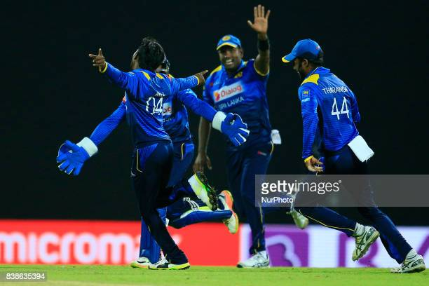 Sri Lankan cricketer and spinner Akila Dananjaya in celebration mood as he is joined by his team mates during the 2nd One Day International cricket...