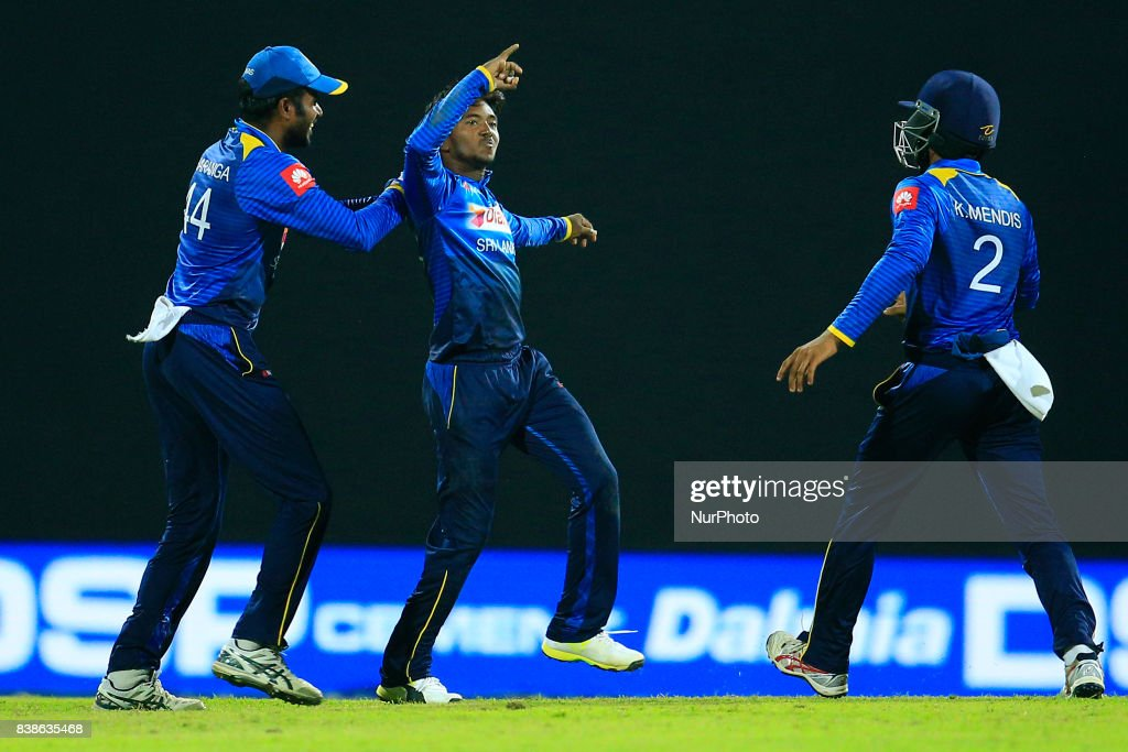 Sri Lankan cricketer and spinning bowler Akila Dananjaya in celebration mood as his captain Upul Tharanga joins in after taking a wicket during the 2nd One Day International cricket match between Sri Lanka and India at the Pallekele international cricket stadium at Kandy, Sri Lanka on Thursday 24 August 2017.