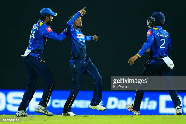 Sri Lankan cricketer and spinning bowler Akila Dananjaya in celebration mood as his captain Upul Tharanga joins in after taking a wicket during the...