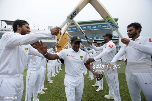 Sri Lankan cricketer and the most successful left arm bowler in Test cricket Rangana Herath receives a guard of honor by his team mates as he walks...