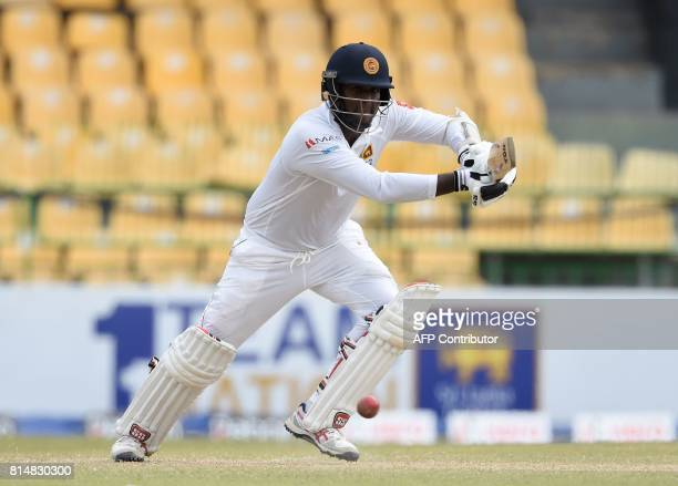 Sri Lankan cricketer Angelo Mathews plays a shot during the second day of the only oneoff Test match between Sri Lanka and Zimbabwe at the R...