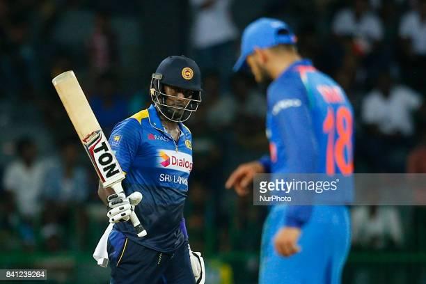 Sri Lankan cricketer Angelo Mathews raises his bat after scoring 50 runs during the 4th One Day International cricket match between Sri Lanka and...