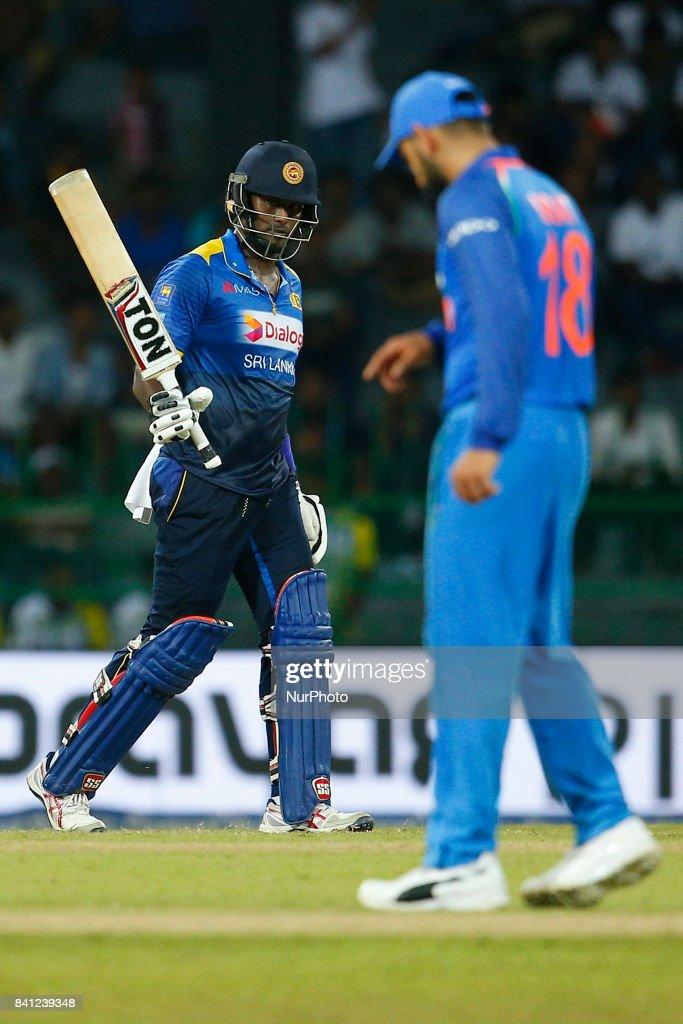 Sri Lankan cricketer Angelo Mathews raises his bat after scoring 50 runs during the 4th One Day International cricket match between Sri Lanka and India at the R Premadasa international cricket stadium at Colombo, Sri Lanka on Thursday 31 August 2017.