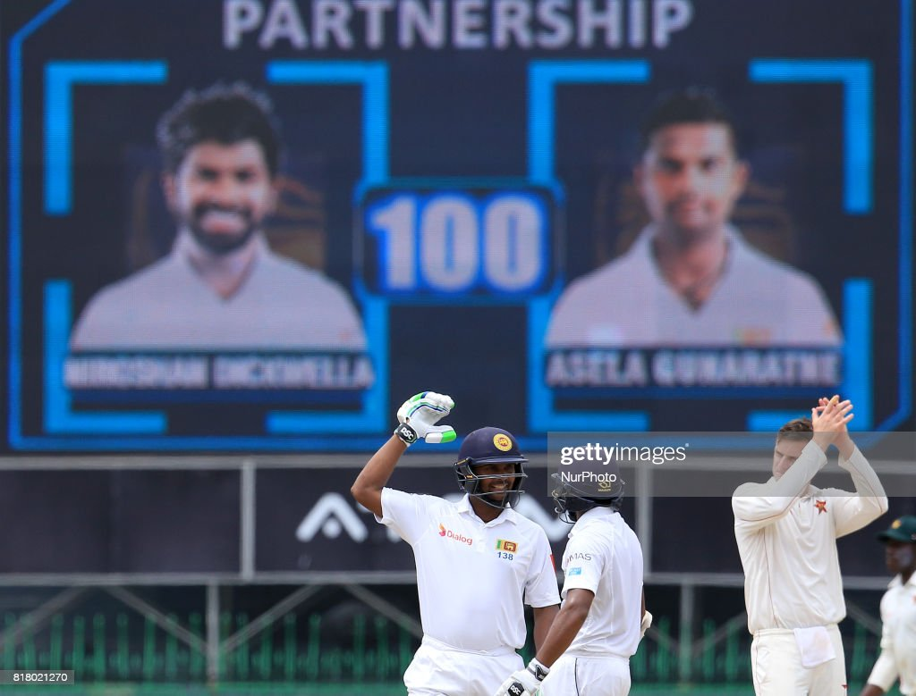 Sri Lankan cricketer Asela Gunaratne (L) and Niroshan Dickwella look on after putting up a 100 run partnership during the final day's play in the only test match between Sri Lanka and Zimbabwe at R Premadasa International Cricket stadium, Colombo, Sri Lanka on Tuesday 18 July 2017