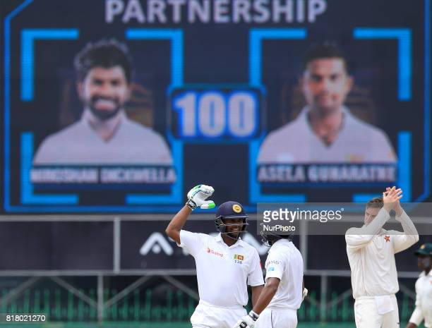 Sri Lankan cricketer Asela Gunaratne and Niroshan Dickwella look on after putting up a 100 run partnership during the final day's play in the only...