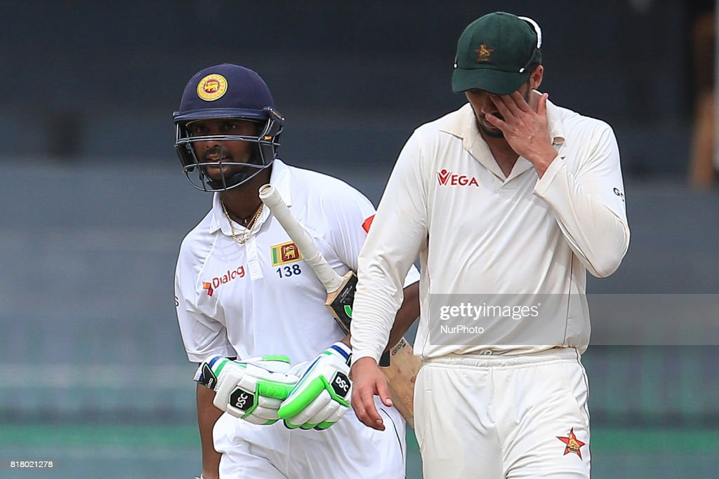 Sri Lankan cricketer Asela Gunaratne(L) who ensured Sri Lankan cricket team pull off the highest successful run chase in a test match in Asia walks away as Zimbabwe captain Graeme Cremer(R) reacts during the final day's play in the only test match between Sri Lanka and Zimbabwe at R Premadasa International Cricket stadium, Colombo, Sri Lanka on Tuesday 18 July 2017