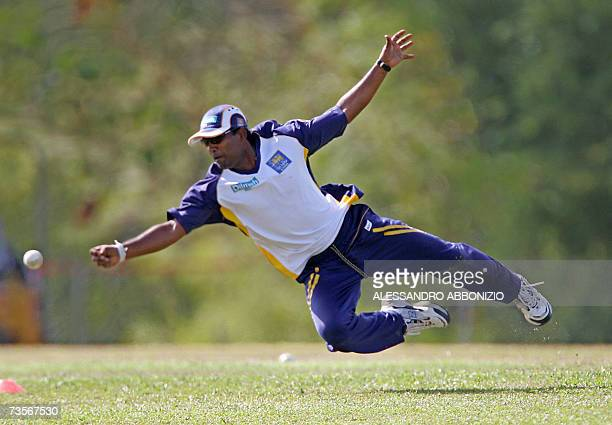 Sri Lankan cricketer Chamara Silva dives for the ball during a team training session in Couva in central Trinidad and Tobago 13 March 2007 Sri Lanka...