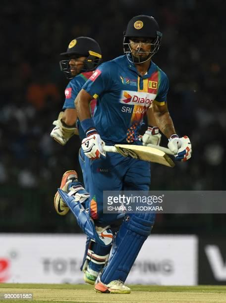 Sri Lankan cricketer Danushka Gunathilaka and Kusal Mendis runs between the wickets during the third Twenty20 international cricket match between...