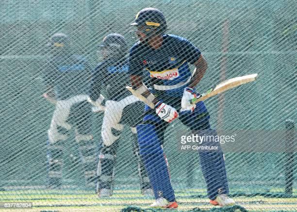 Sri Lankan cricketer Danushka Gunathilaka bats during a practice session at the Pallekele International Cricket Stadium in Pallekele on August 23...
