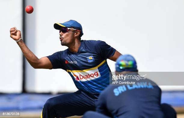 Sri Lankan cricketer Danushka Gunathilaka catches the ball during a practice session at the R Premadasa Cricket Stadium in Colombo on July 13 2017...