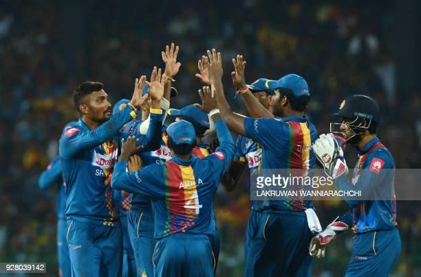 Sri Lankan cricketer Danushka Gunathilaka celebrates with his teammates after he dismissed Indian cricketer Shikhar Dhawan during the opening...