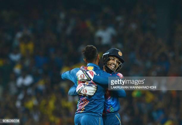 Sri Lankan cricketer Danushka Gunathilaka celebrates with his wicketkeeper Dinesh Chandimal after he dismissed Indian cricketer Shikhar Dhawan during...