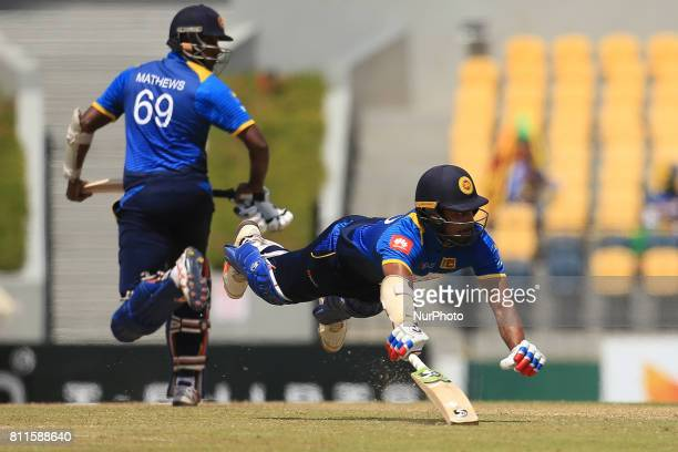 Sri Lankan cricketer Danushka Gunathilaka dives in for a run during the 5th One Day International cricket matcth between Sri Lanka and Zimbabwe at...