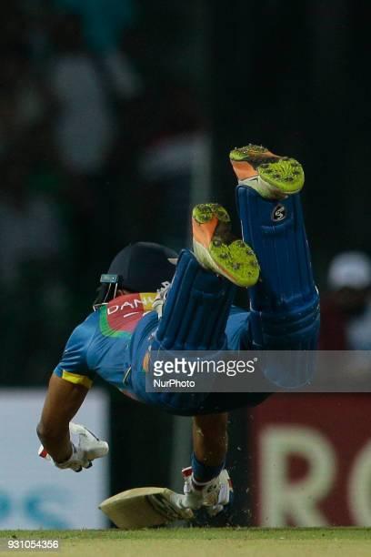 Sri Lankan cricketer Danushka Gunathilaka dives in for a run during the 4th Twenty20 cricket match of NIDAHAS Trophy between Sri Lanka and India at R...