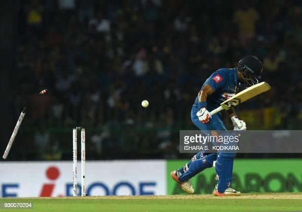 Sri Lankan cricketer Danushka Gunathilaka gets dismissed by Bangladesh cricketer Mustafizur Rahman during the third Twenty20 international cricket...