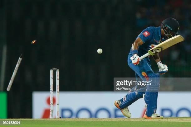 Sri Lankan cricketer Danushka Gunathilaka is bowled out during the 3rd T20 cricket match of NIDAHAS Trophy between Sri Lanka and Bangladesh at R...