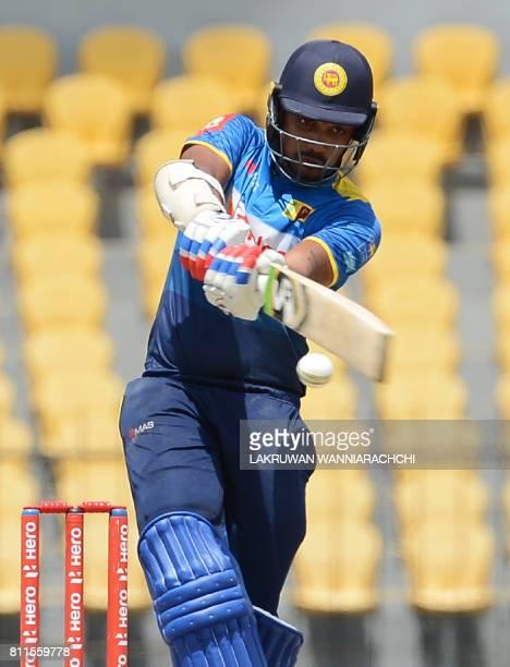 Sri Lankan cricketer Danushka Gunathilaka plays a shot during the fifth oneday international cricket match between Sri Lanka and Zimbabwe at the...