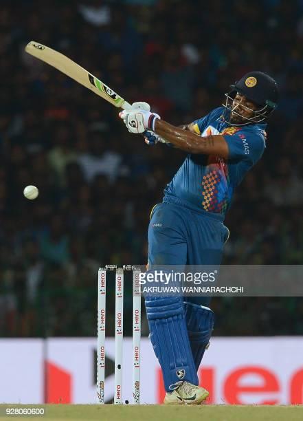 Sri Lankan cricketer Danushka Gunathilaka plays a shot during the opening Twenty20 international cricket match between Sri Lanka and India of the...