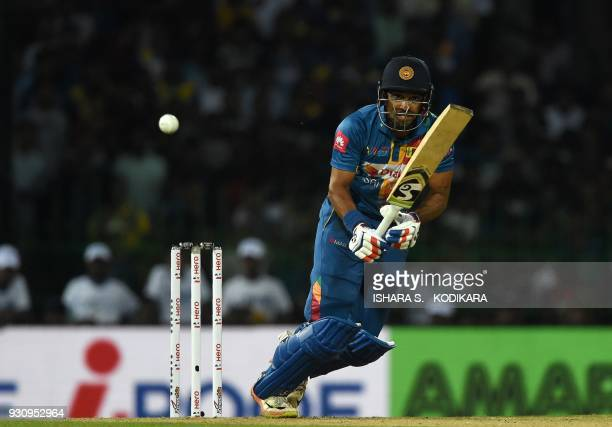 Sri Lankan cricketer Danushka Gunathilaka plays a shot during the fourth Twenty20 international cricket match between India and Sri Lanka of the...