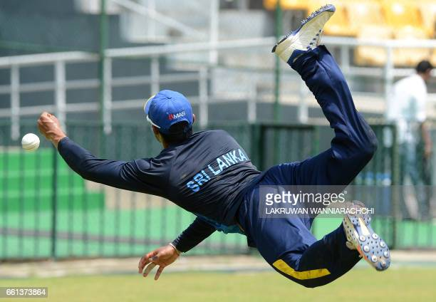 Sri Lankan cricketer Danushka Gunathilaka prepares to catch a ball during a practice session at the R Premadasa Stadium in Colombo on March 31 2017...