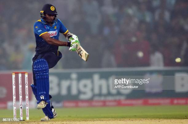 Sri Lankan cricketer Dasun Shanaka plays a shot during the third and final T20 cricket match between Pakistan and Sri Lanka at the Gaddafi Cricket...