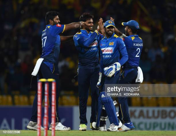 Sri Lankan cricketer Dhananjaya de Silva celebrates with teammates after he dismissed South Africa's Willem Mulder during the fourth One Day...