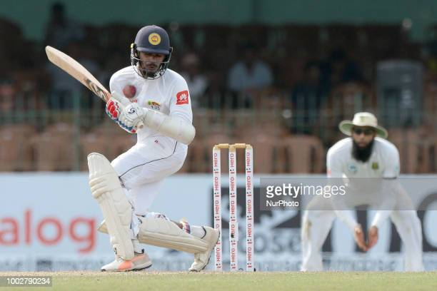 Sri Lankan cricketer Dhananjaya de Silva is hit in the chest with the ball during the first day of the 2nd test cricket match between Sri Lanka and...
