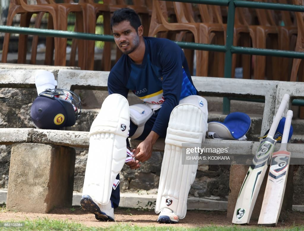 Sri Lankan cricketer Dhananjaya de Silva pads up during a practice session at The P. Sara Oval Cricket Stadium in Colombo on March 14, 2017. Bangladesh play their 100th Test on March 15, against Sri Lanka at The P. Sara Oval Cricket Stadium in Colombo. / AFP PHOTO / Ishara S. KODIKARA