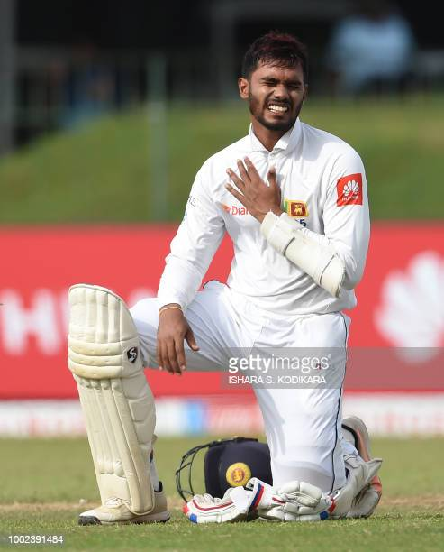 Sri Lankan cricketer Dhananjaya De Silva reacts after being hit by a ball delivered by South Africa's Kagiso Rabada during the first day of the...