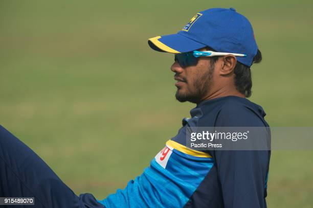 Sri Lankan cricketer Dhananjaya de Silva stretches during a training session ahead of their second test cricket match against Bangladesh in Dhaka