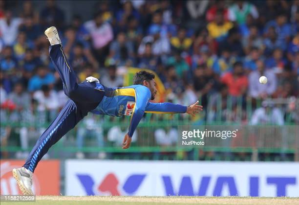 Sri Lankan cricketer Dhananjaya de Silva tries to completes a catch during the 2nd One Day International cricket match between Sri Lanka and...