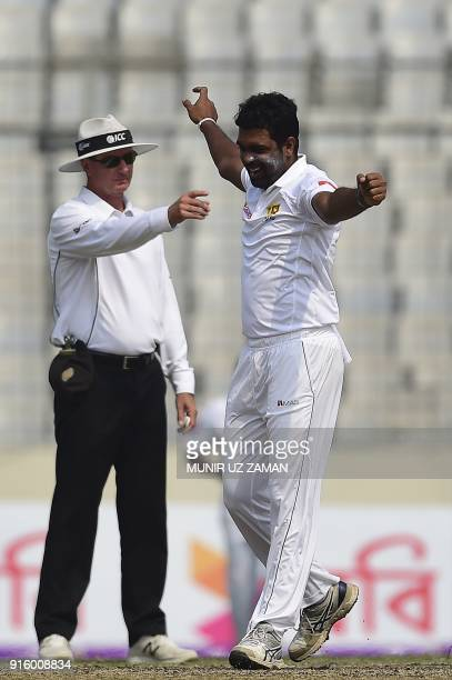 Sri Lankan cricketer Dilruwan Perera reacts after the dismissal of the Bangladesh cricketer Mustafizur Rahman during the second day of the second...