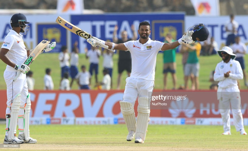 Sri Lankan cricketer Dimuth Karunaratne celebrates after scoring 100 runs during the 1st Day's play of the 1st Test match between Sri Lanka and South Africa at Galle International Cricket stadium, Galle on Thursday 12 July 2018.