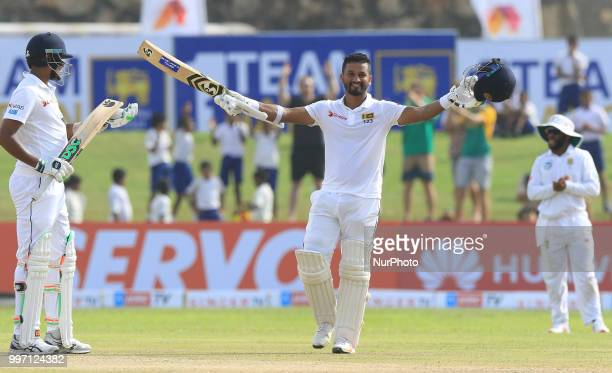 Sri Lankan cricketer Dimuth Karunaratne celebrates after scoring 100 runs during the 1st Day's play of the 1st Test match between Sri Lanka and South...