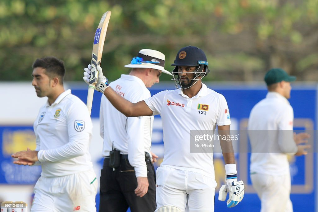Sri Lankan cricketer Dimuth Karunaratne celebrates after scoring 150 runs during the first day's play in the 1st Test cricket match between Sri Lanka and South Africa at Galle International cricket stadium, Galle, Sri Lanka on Thursday 12 July 2018