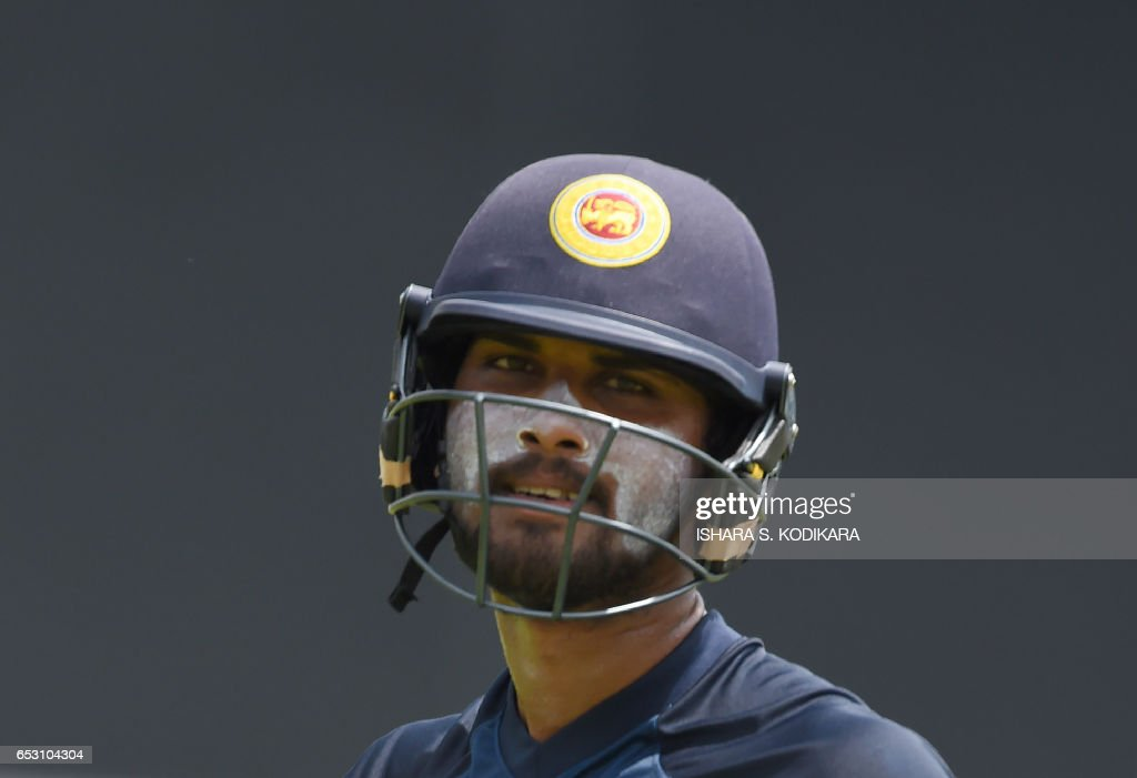 Sri Lankan cricketer Dinesh Chandimal looks on during a practice session at The P. Sara Oval Cricket Stadium in Colombo on March 14, 2017. Bangladesh play their 100th Test on March 15, against Sri Lanka at The P. Sara Oval Cricket Stadium in Colombo. / AFP PHOTO / Ishara S. KODIKARA