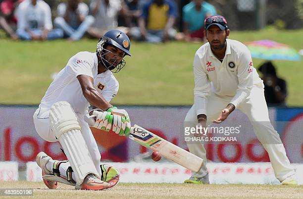 Sri Lankan cricketer Dinesh Chandimal plays a shot during the third day of the opening Test match between Sri Lanka and India at the Galle...