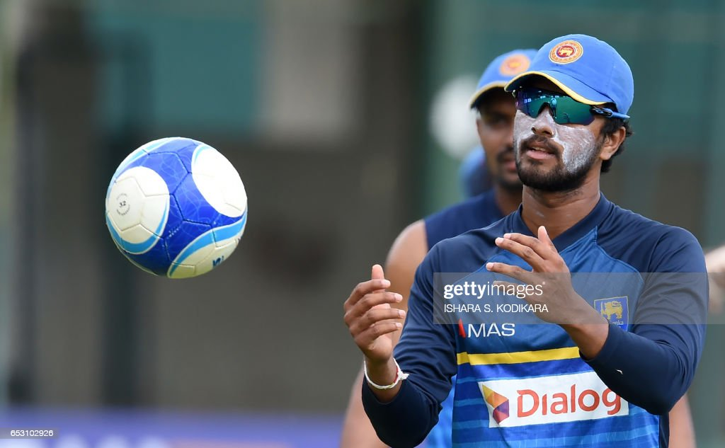 Sri Lankan cricketer Dinesh Chandimal plays football during a practice session at The P. Sara Oval Cricket Stadium in Colombo on March 14, 2017. Bangladesh play their 100th Test on March 15, against Sri Lanka at The P. Sara Oval Cricket Stadium in Colombo. / AFP PHOTO / Ishara S. KODIKARA