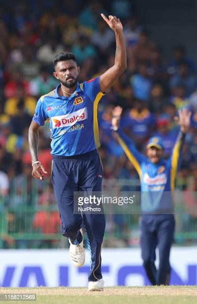 Sri Lankan cricketer Isuru Udana celebrates after taking a wicket during the 2nd One Day International cricket match between Sri Lanka and Bangladesh...