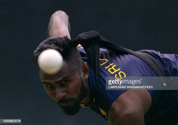 TOPSHOT Sri Lankan cricketer Isuru Udana delivers the ball during a practice session at the R Peremadasa Stadium in Colombo on October 26 2018 Sri...