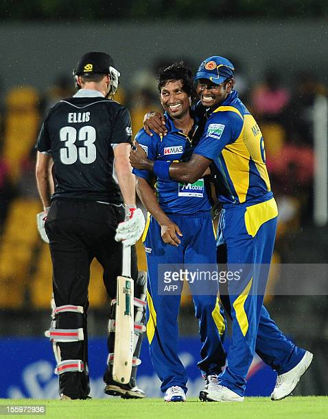 Sri Lankan cricketer Jeevan Mendis celebrates with his teammate Angelo Mathews the dismissal of New Zealand cricketer Andrew Ellis during the fourth...