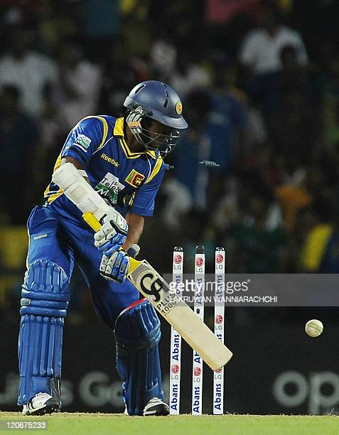 Sri Lankan cricketer Jeevan Mendis gets dismissed by Australian cricketer John Hastings during the second Twenty20 match between Sri Lanka and...
