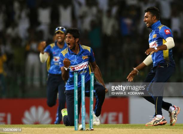 Sri Lankan cricketer Kasun Rajitha celebrates after he dismissed England cricketer Jason Roy during the fifth and final one day international cricket...