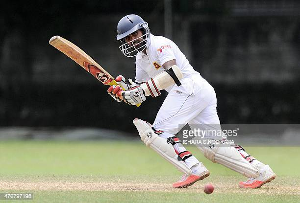Sri Lankan cricketer Kaushal Silva plays a shot during the second day of the three day warm-up match between Sri Lanka Board President's XI and...
