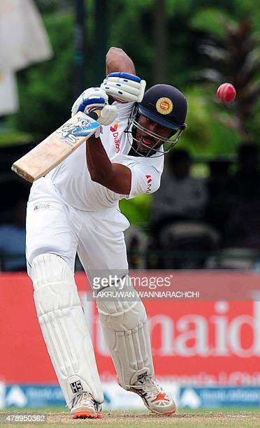 Sri Lankan cricketer Kithruwan Vithanage plays a shot during the final day of the second Test cricket match between Sri Lanka and Pakistan at the P...