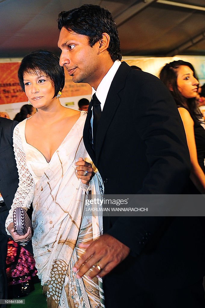 Sri Lankan cricketer Kumar Sangakkara (R) and his wife Yahale arrive at the International Indian Film Academy (IIFA) awards in Colombo on June 5, 2010. Bollywood actors arrived in Sri Lanka to attend the three-day International Indian Film Academy (IIFA) awards and surrounding events that begun in Colombo on June 3. AFP PHOTO/ Lakruwan WANNIARACHCHI.
