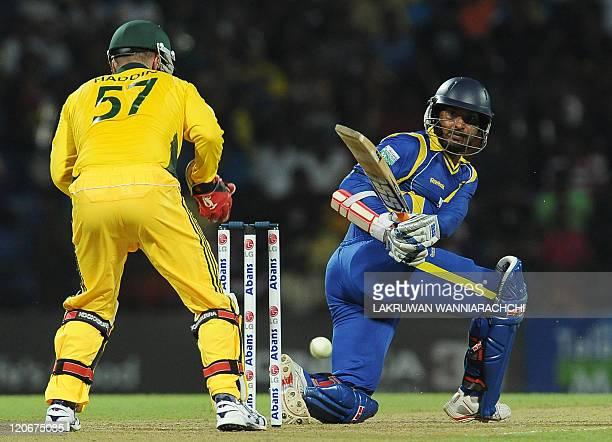 Sri Lankan cricketer Kumar Sangakkara is watched by Australian wicketkeeper Brad Haddin as he plays a shot during the second Twenty20 match between...