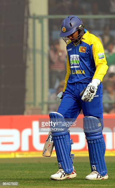 Sri Lankan cricketer Kumar Sangakkara walks back to the pavilion after his dismissal during the fifth and final One Day International cricket match...