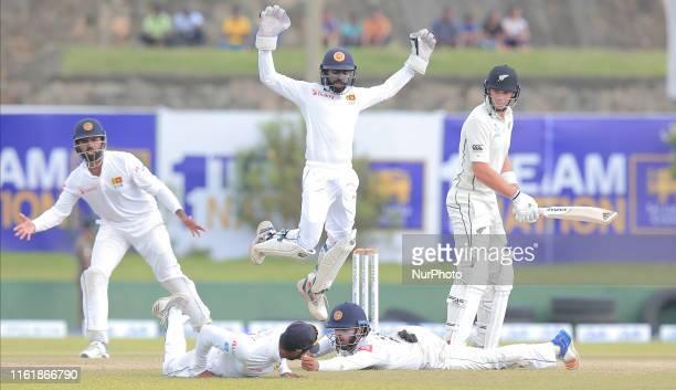 Sri Lankan cricketer Kusal Mendis fails to complete a catch as Dhananjaya de Silva Niroshan Dickwella Lahiru Thirimanne react while New Zealand...